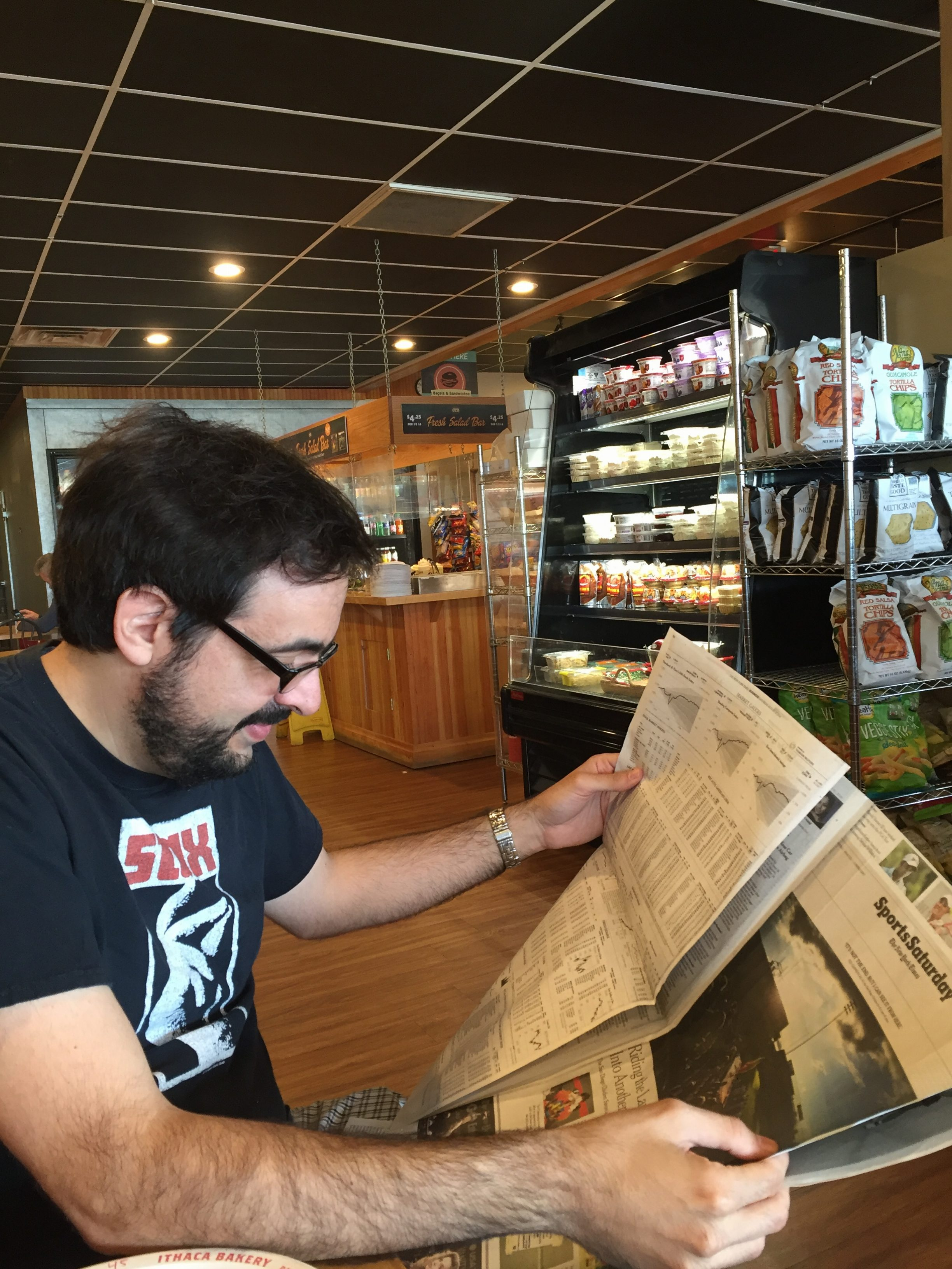 Pete Croatto reading the paper.